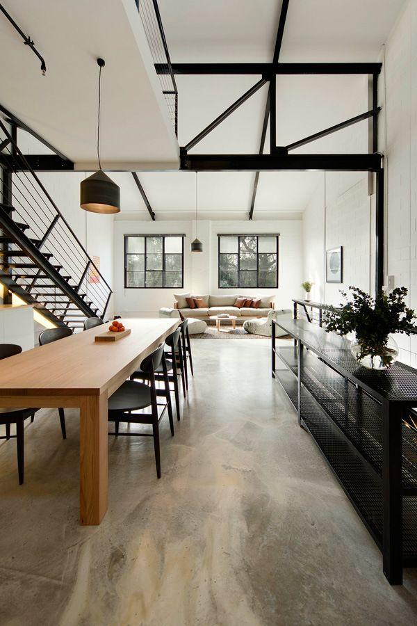 Spacious home with wooden table and bold black elements.
