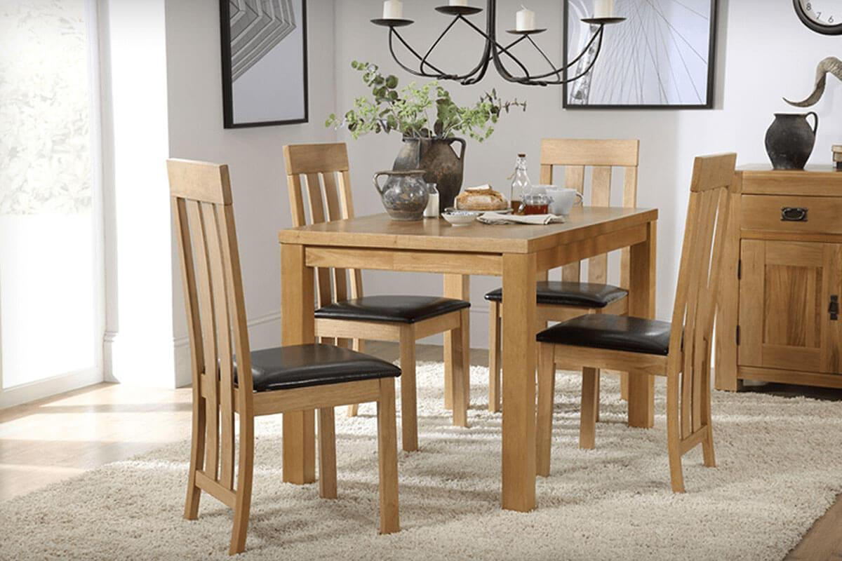 Union Square Oak dining table with 4 Kendal dining chairs with brown seats