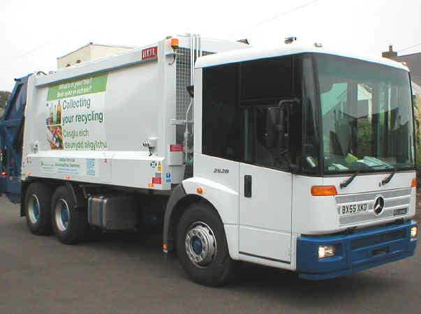 White truck that collects unwanted furniture for recycling.