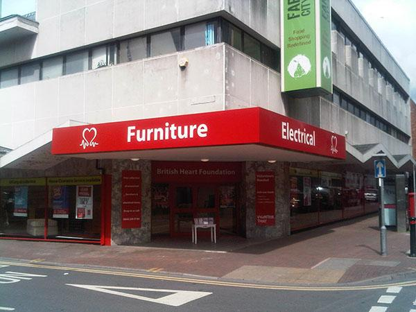 Red furniture shop at the corner of the street.