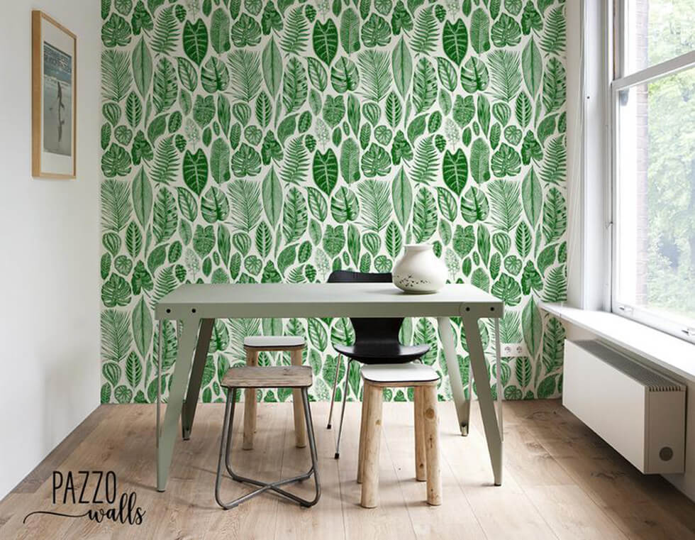 Scandinavian dining room with palm print wallpaper