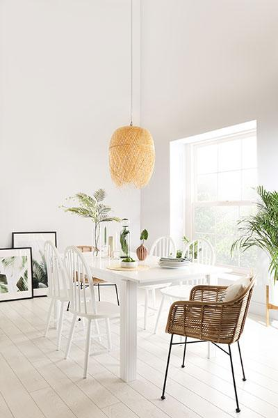 Solid wooden table with white modern chairs.
