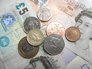 Assortment of British bank notes and coins.