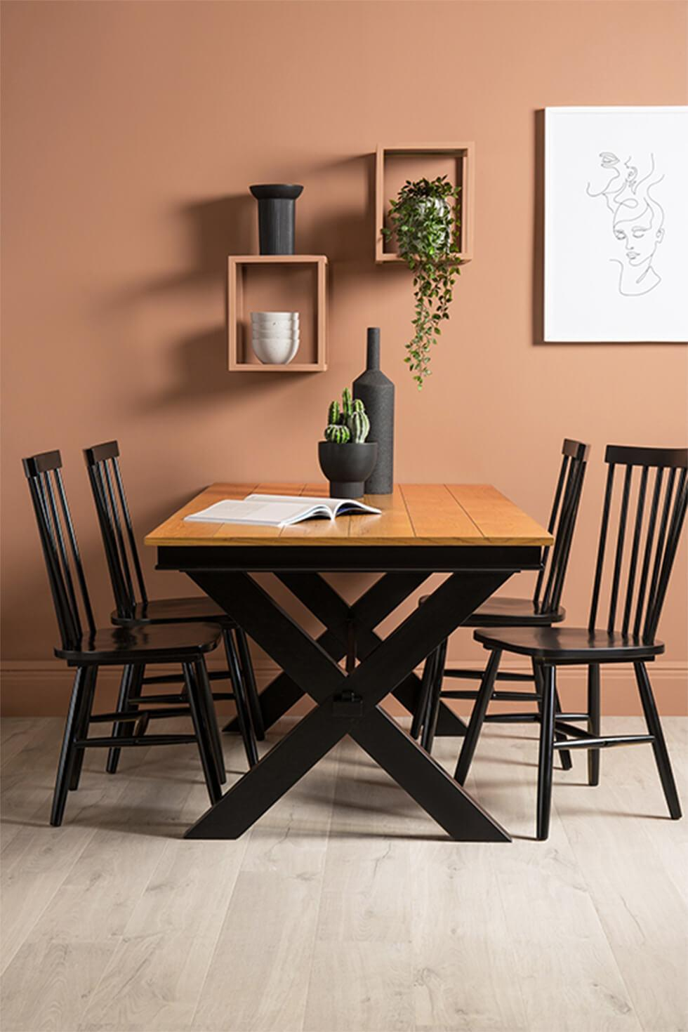 black and oak two tone dining table in a contemporary dining room
