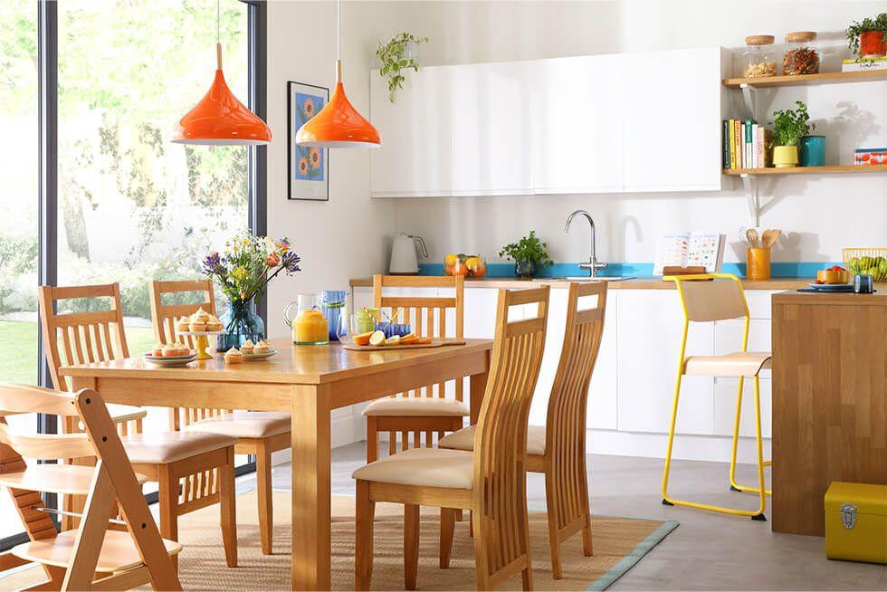 Modern white kitchen-diner with an oak dining set