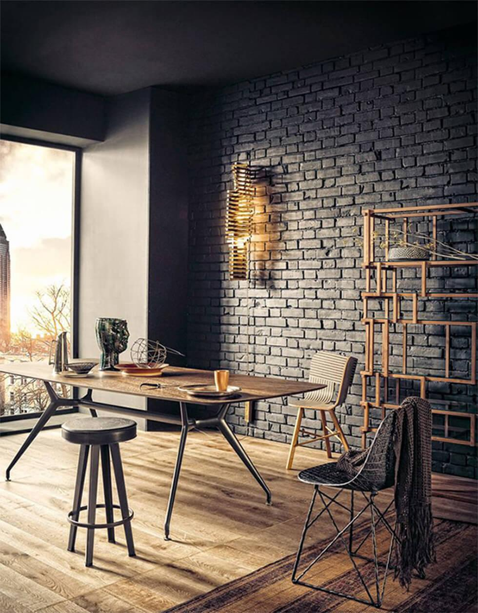 black brick wall in an industrial dining room