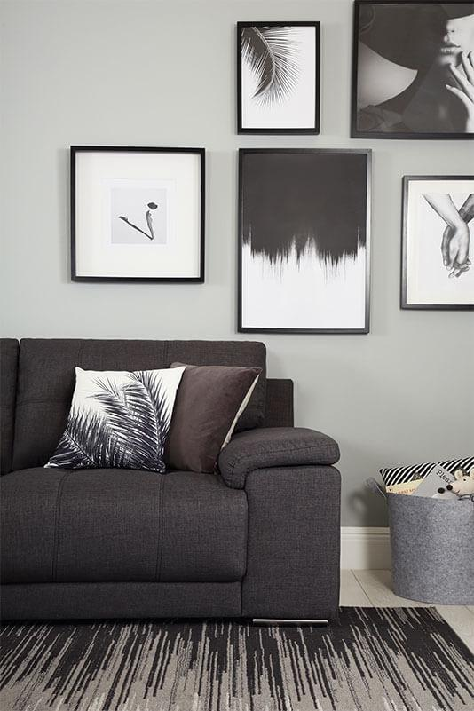 Slate grey sofa in a monochrome living room.