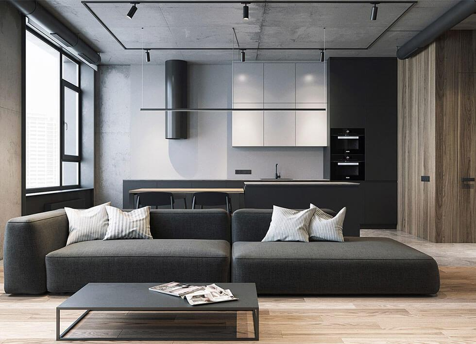Minimalist modern charcoal sofa with thin-legged coffee table in a wood panelled living room.