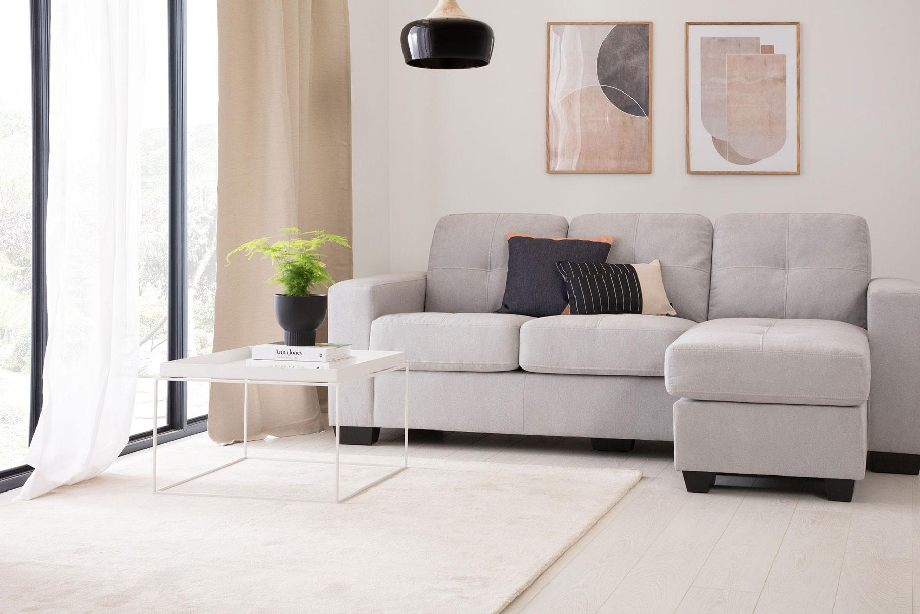Scandinavian style grey living room with a grey sofa