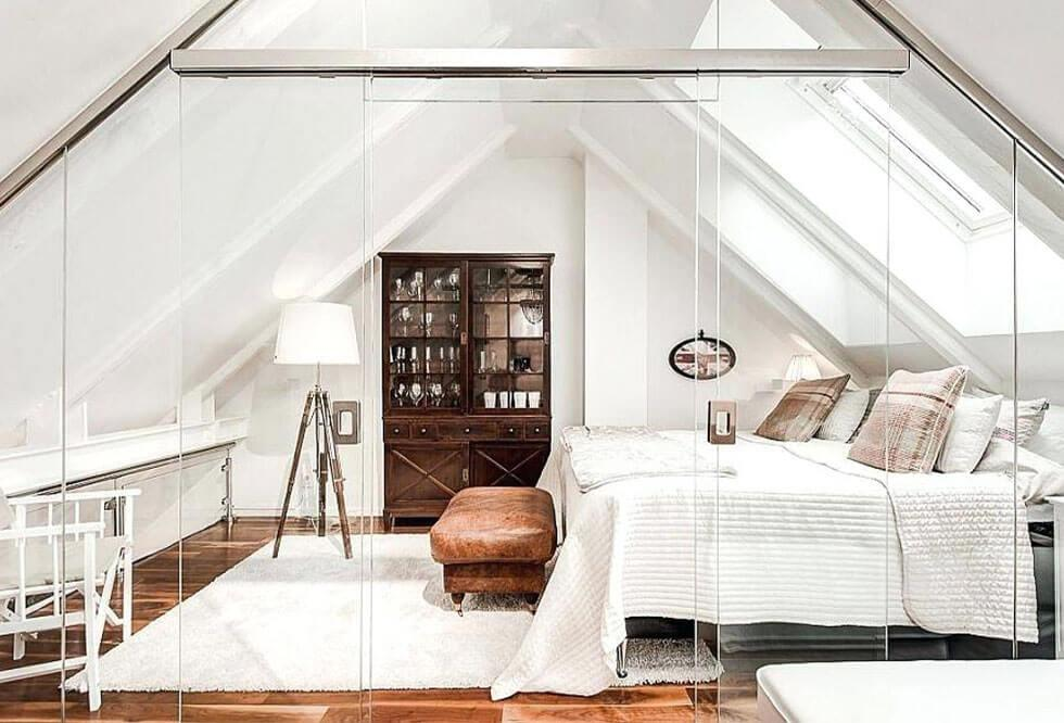White loft bedroom with glass panelling