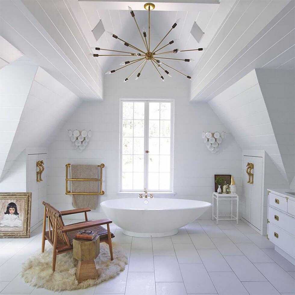 White loft bathroom with luxurious bathtub