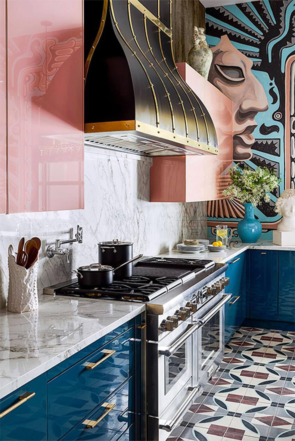 Luxurious high gloss small kitchen with pink cabinets, dark teal drawers and geometric tiles
