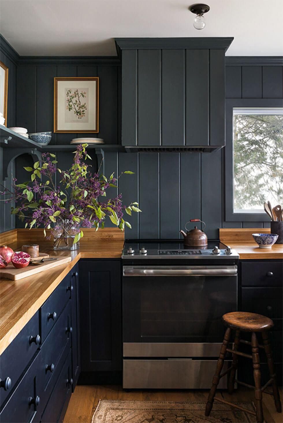 Dark grey small kitchen with a white ceiling and wooden counter tops