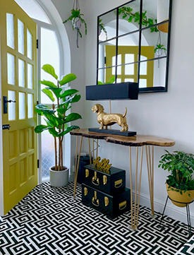 Yellow door and metallic light in a neutral tone entryway