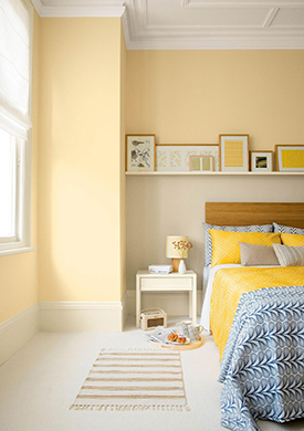 Light yellow walls in a soothing modern bedroom