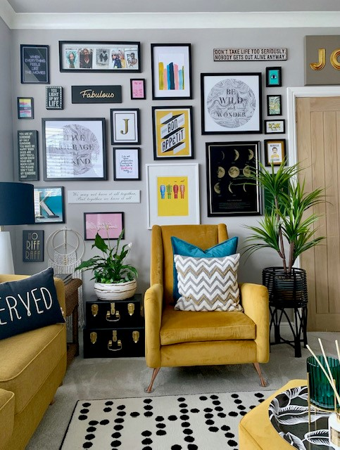 Pops of yellow in a modern grey living room