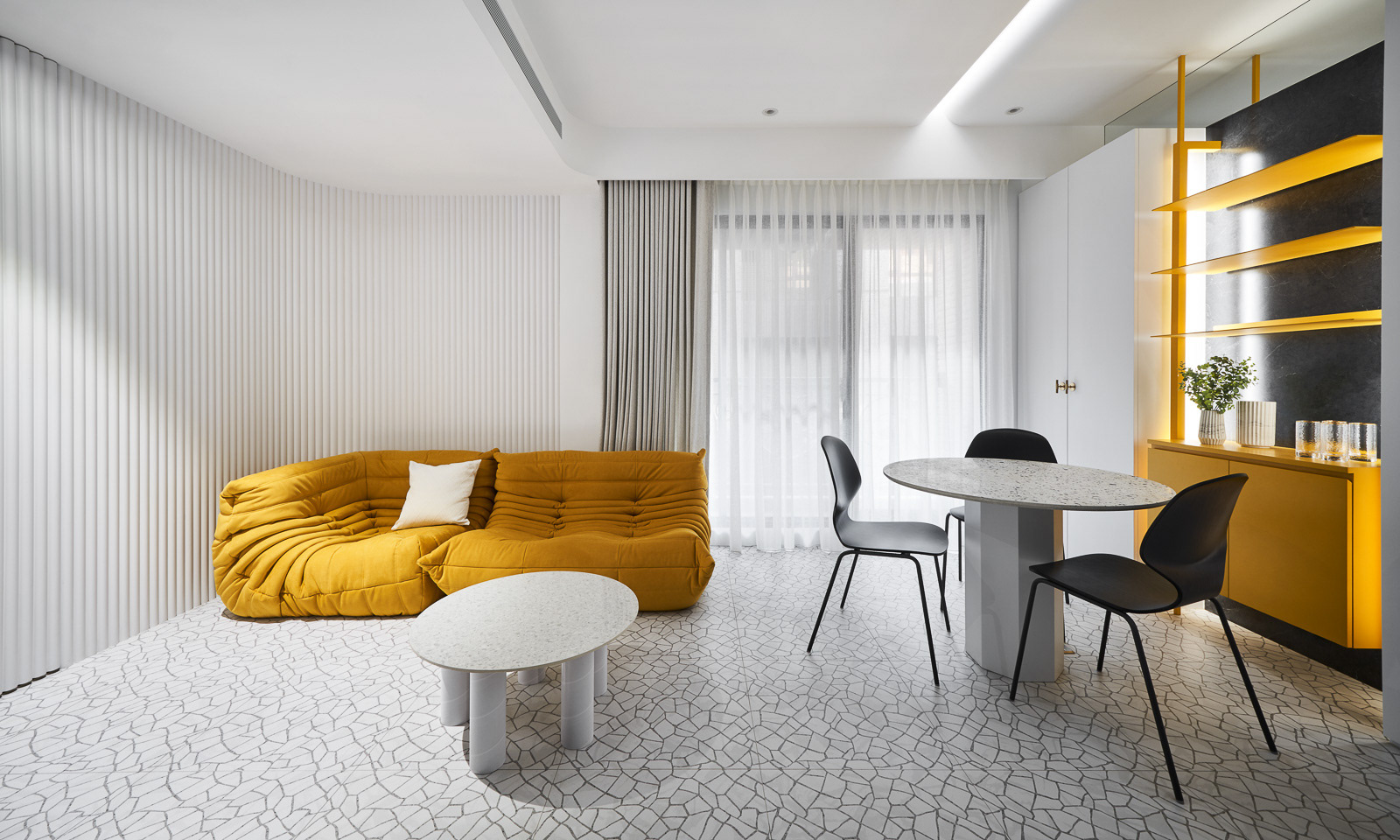 Mustard yellow sofa in a modern grey living room