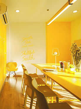 Monochrome yellow dining room