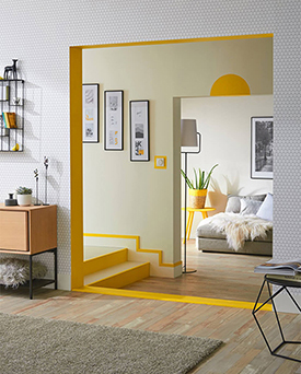 Home interior features like door arches and skirting boards accentuated with yellow paint