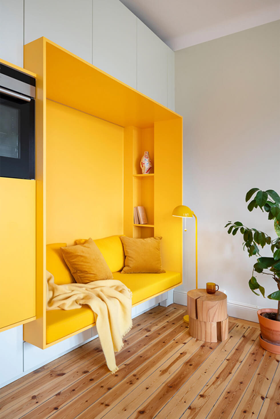 right yellow reading nook with warm oak floorboards