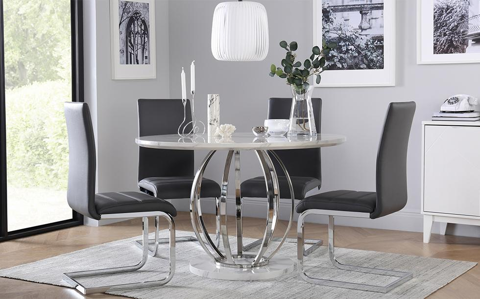 Marble and chrome dining table with grey velvet chairs in a grey modern dining room