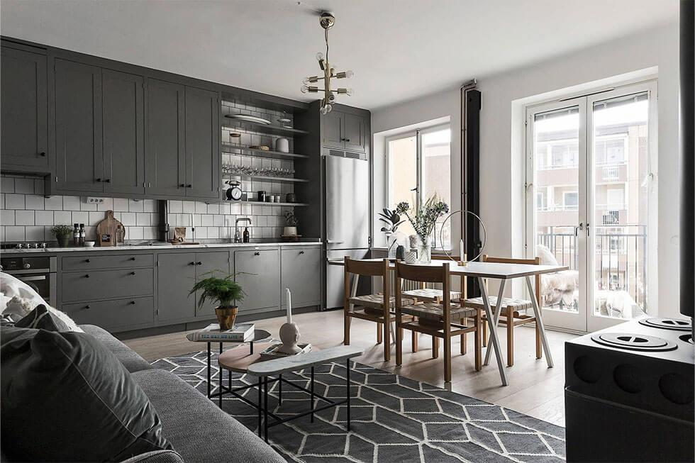 several shades of grey layered up in a monochrome grey dining room
