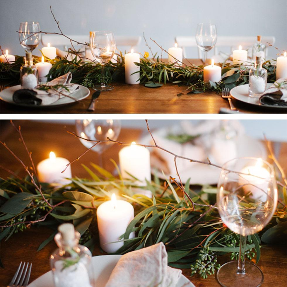 Table centrepiece with leaves and candles.