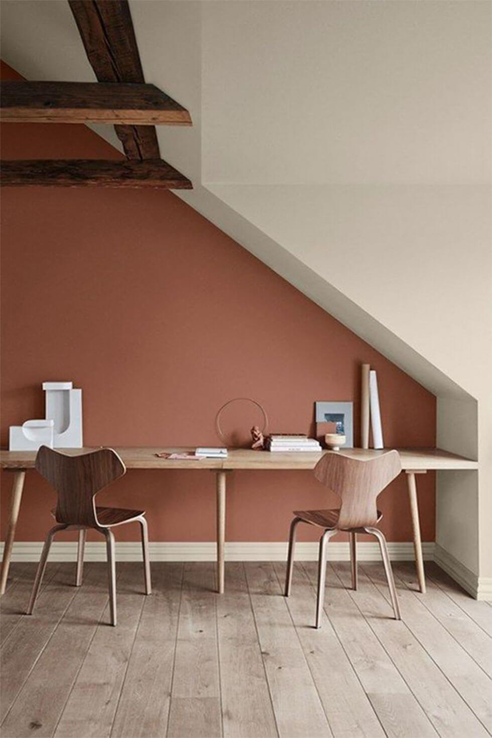 Home office with terracotta walls and oak furniture