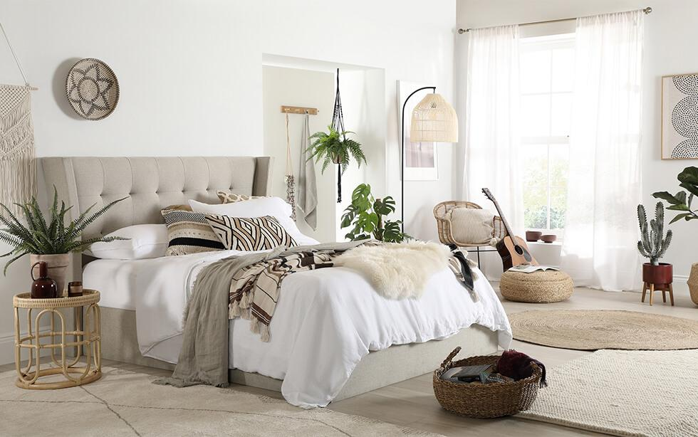 Oatmeal fabric bed in a modern boho natural aesthetic bedroom