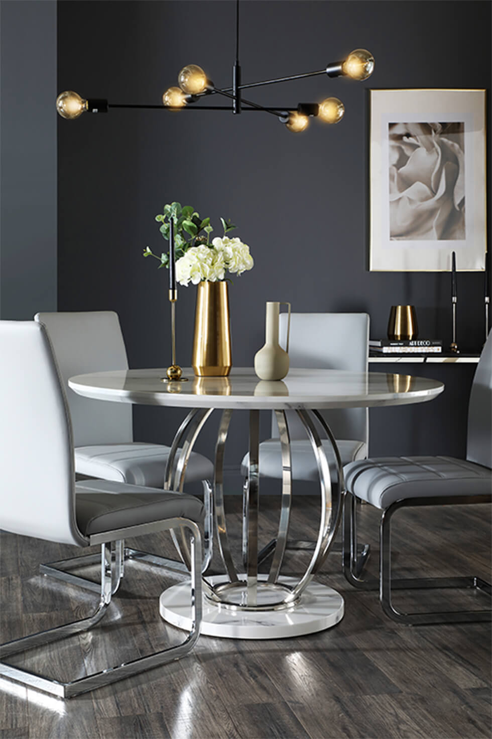 Dark grey dining room with white marble round dining table and grey leather chairs