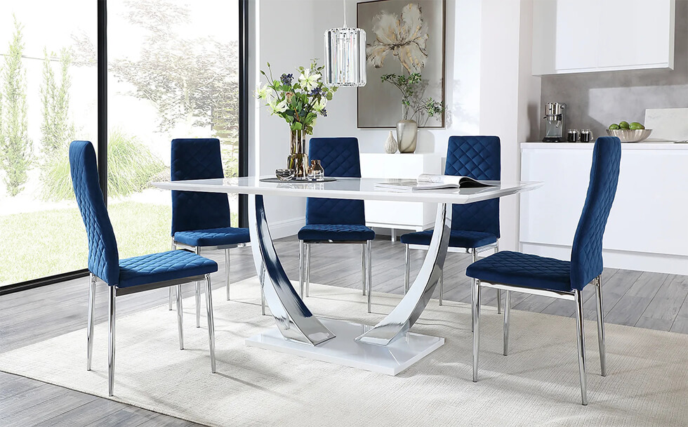 Modern chrome and white marble dining table with blue velvet chairs