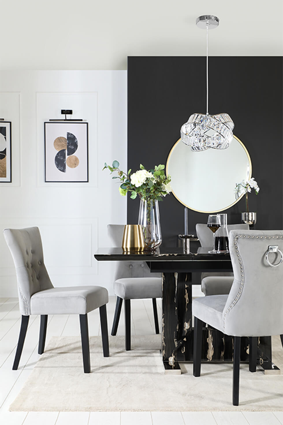 Modern black marble dining table with grey fabric chairs and pendant lamp