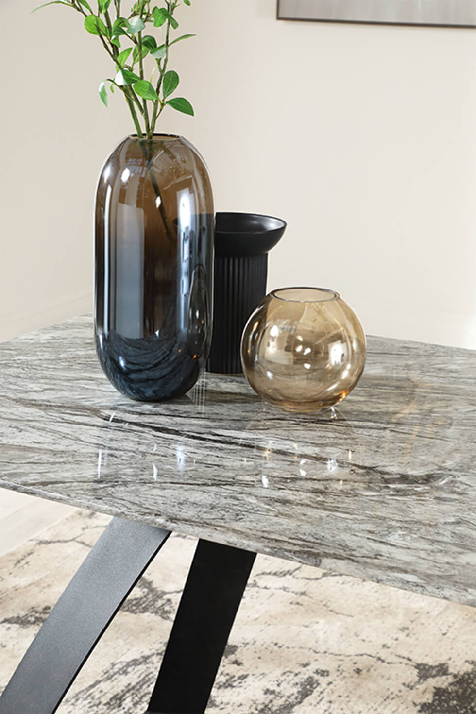 Warm grey dining table with black legs and smoked glass vases