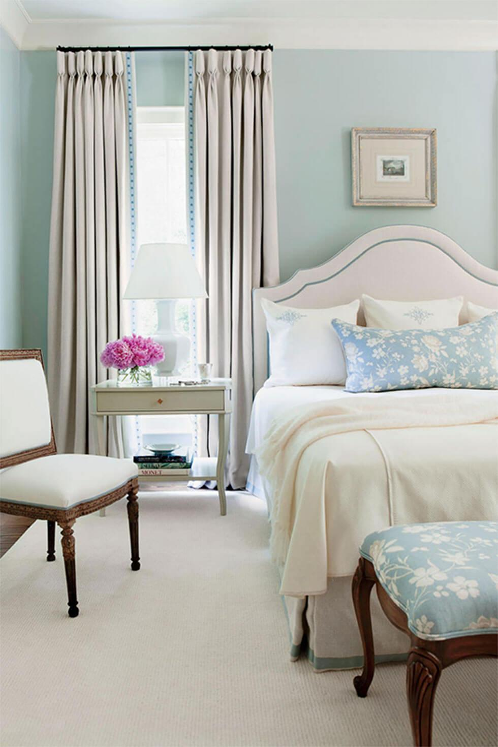 Bedroom walls painted in a pastel blue for a relaxing mood.