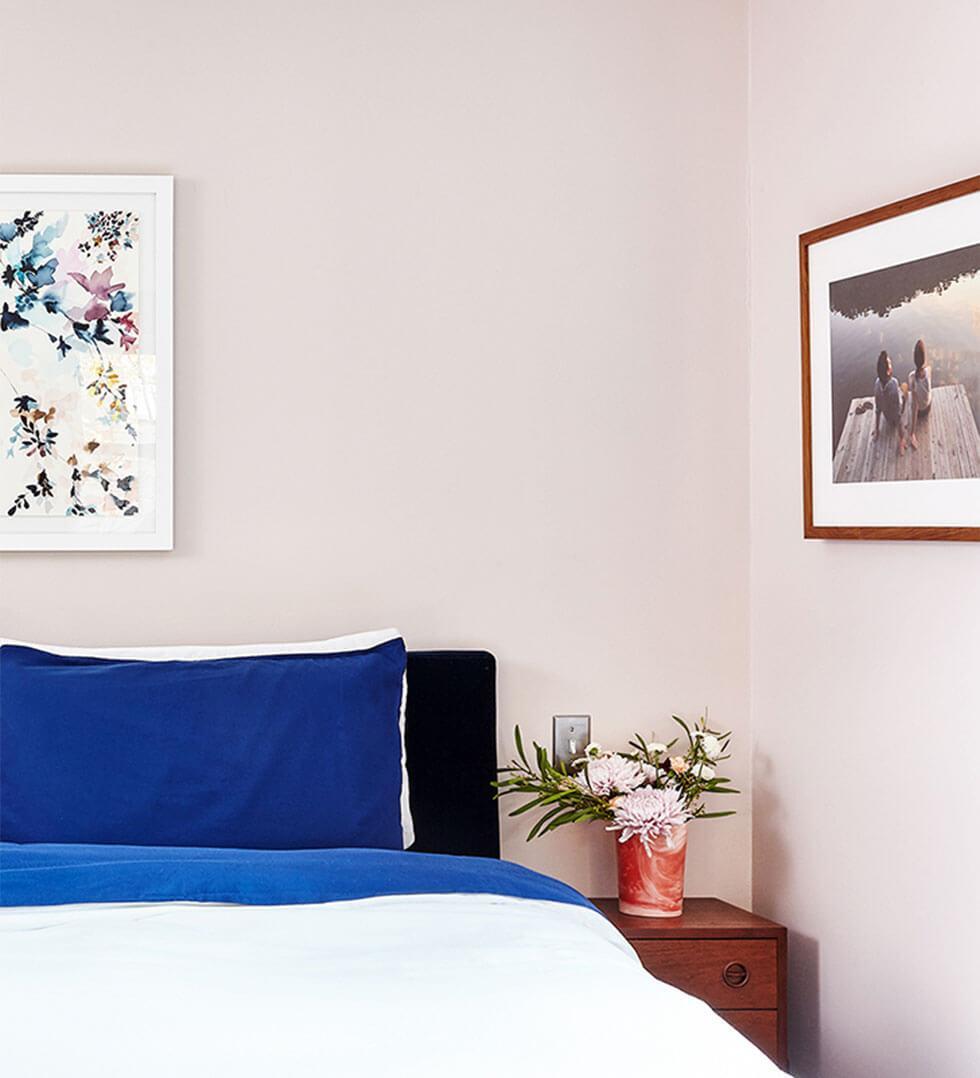 Bedroom walls painted in pastel pink.