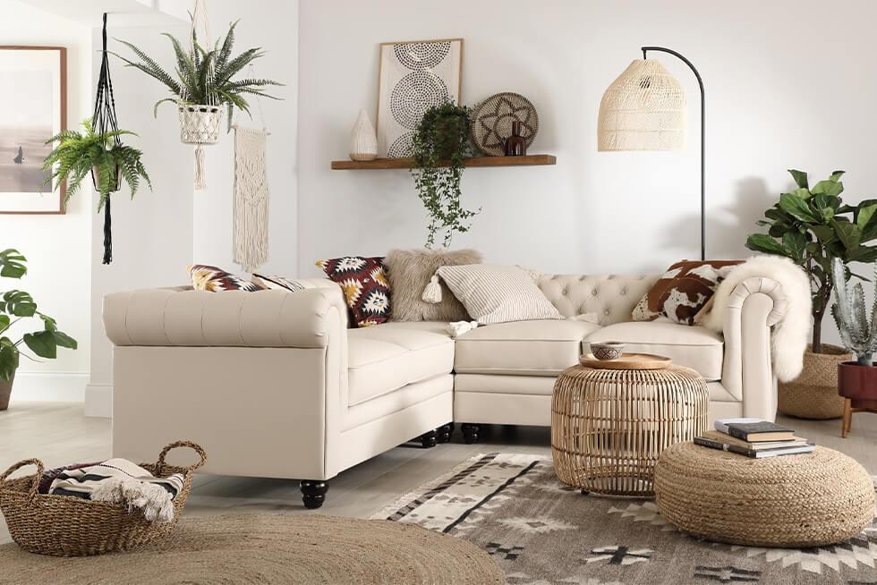 Ivory leather corner sofa in a neutral modern boho space