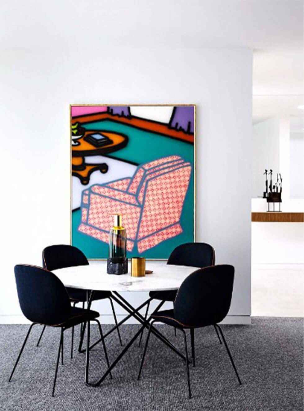 Modern dining room with bold contemporary artwork