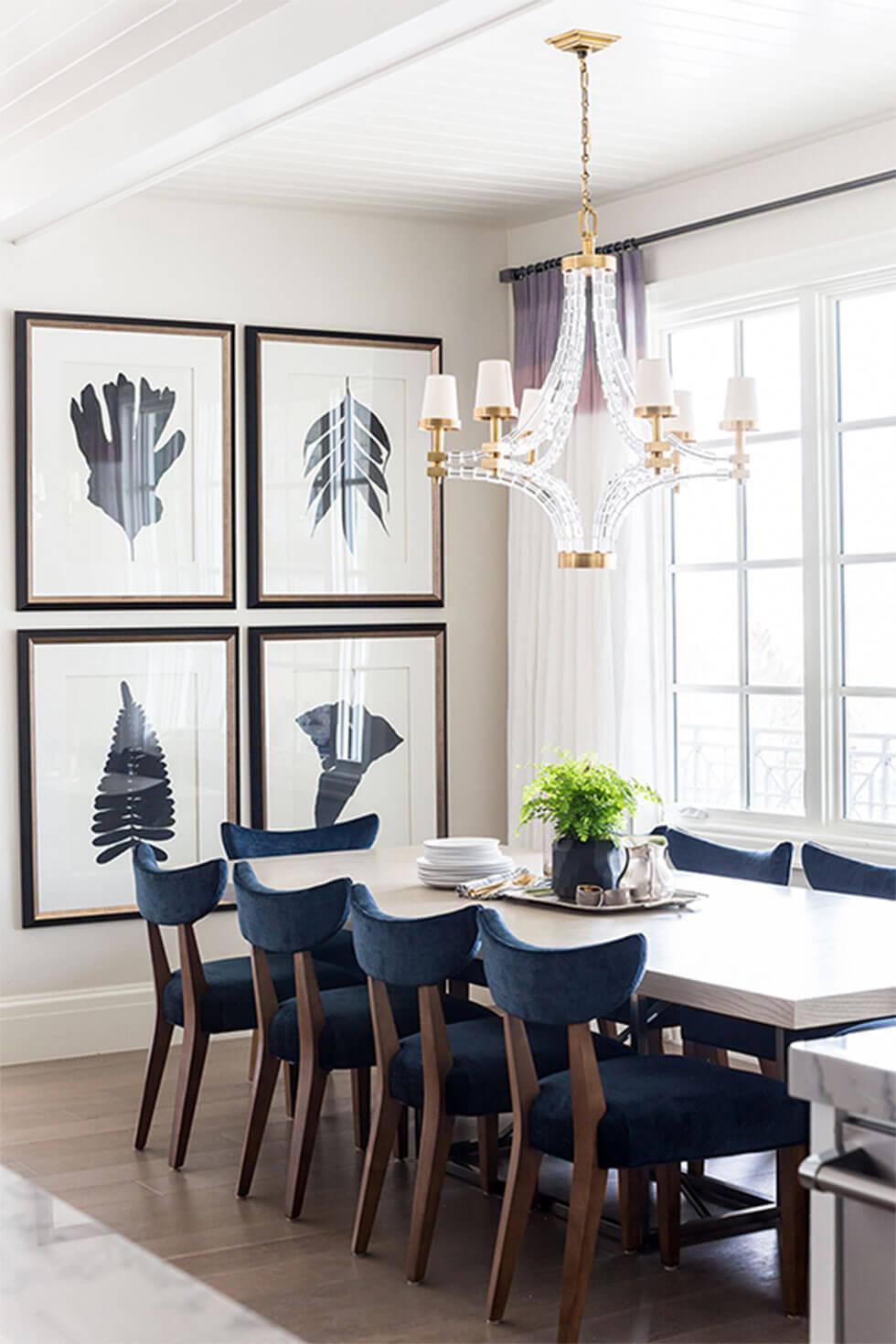 Elegant dining room with framed prints