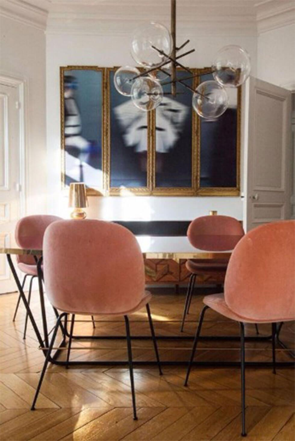 Modern dining room with pink Art Deco-inspired chairs