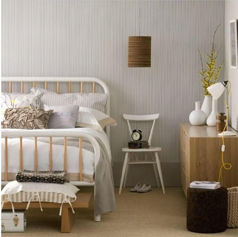 Cosy grey Scandinavian bedroom with white and wooden furniture