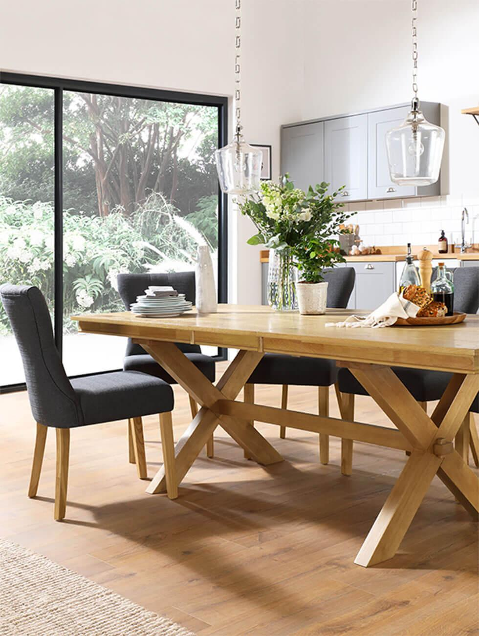 Wooden dining set with dark grey fabric chairs