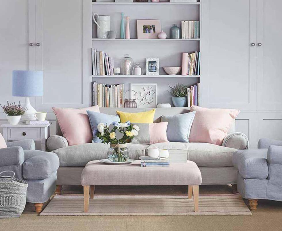 Grey living room with pastel accessories