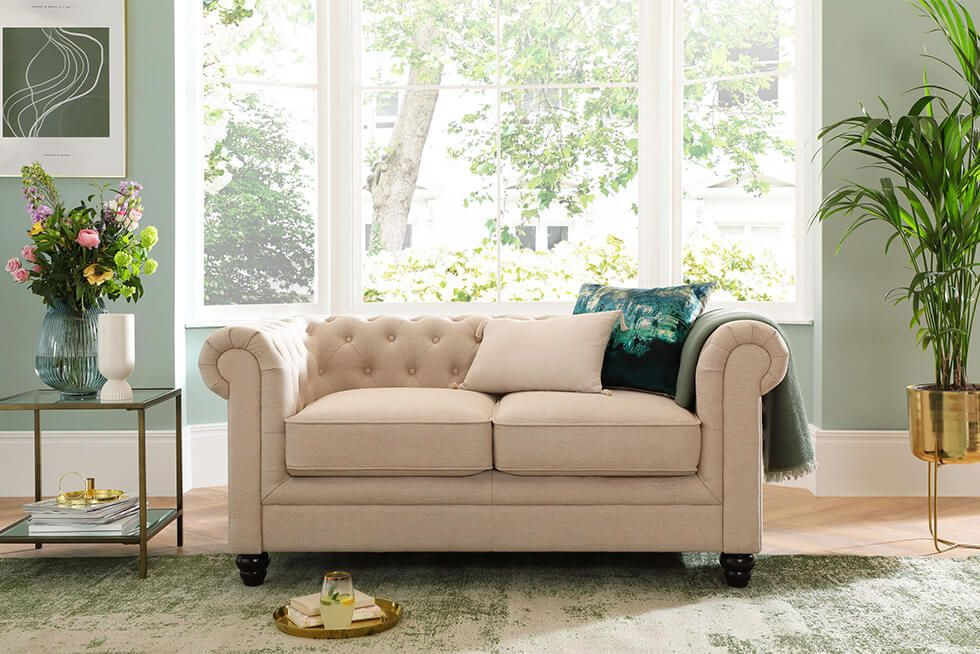 Country style sofa in a fresh and airy living room