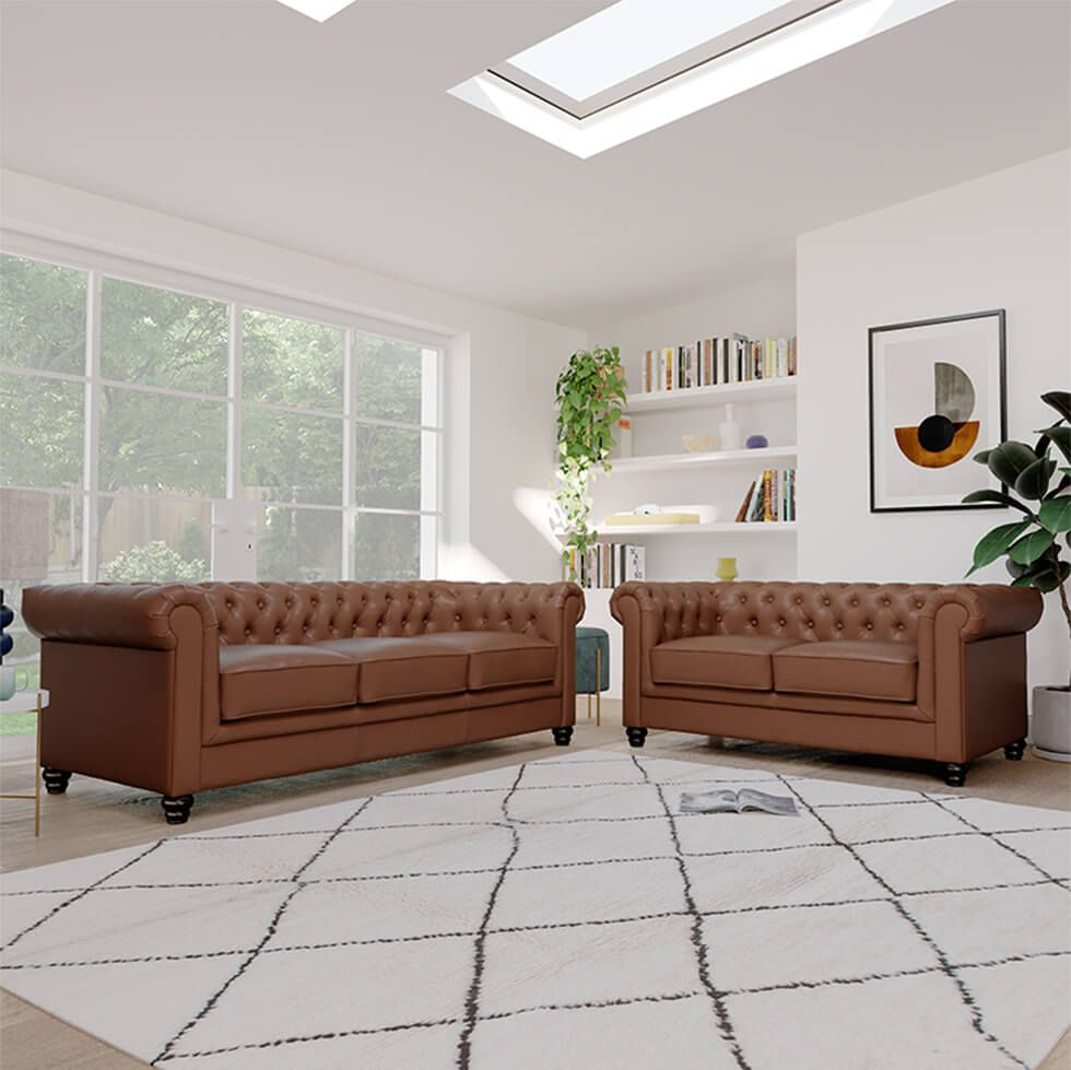 Tan leather chesterfield sofa in a contemporary living room