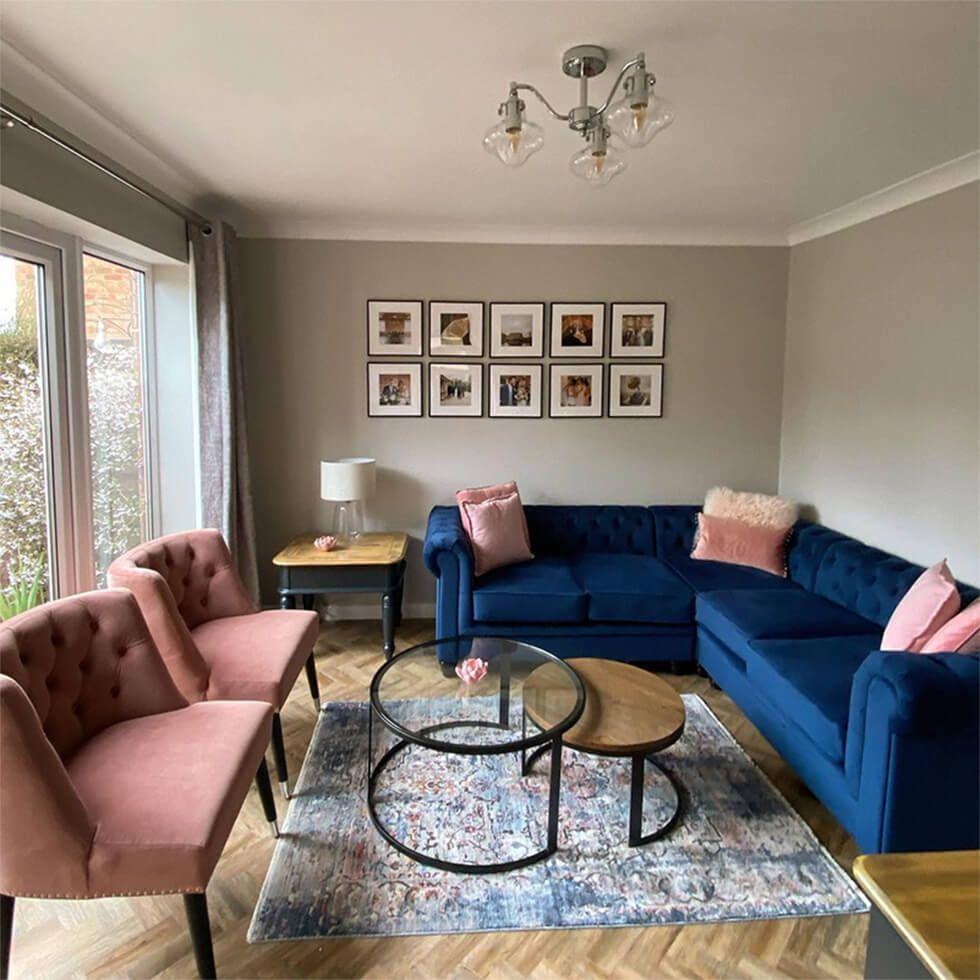 Country style blue velvet sofa in a modern living room