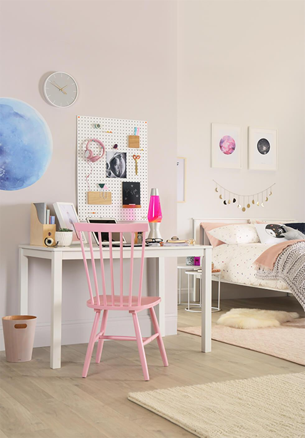 Pink Windsor chair in a soft white bedroom