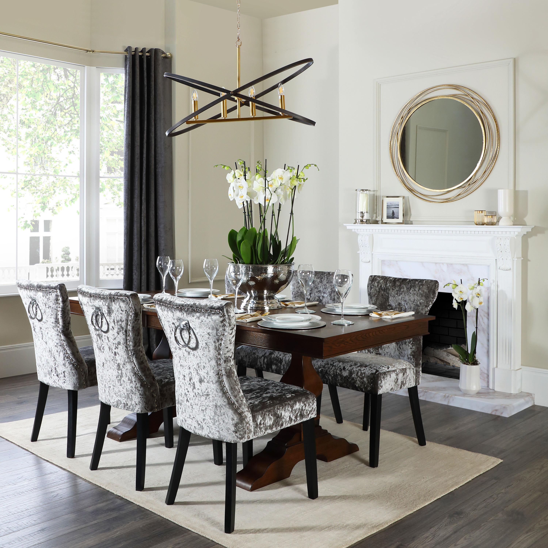 Dark wood extending dining table in an elegant setting