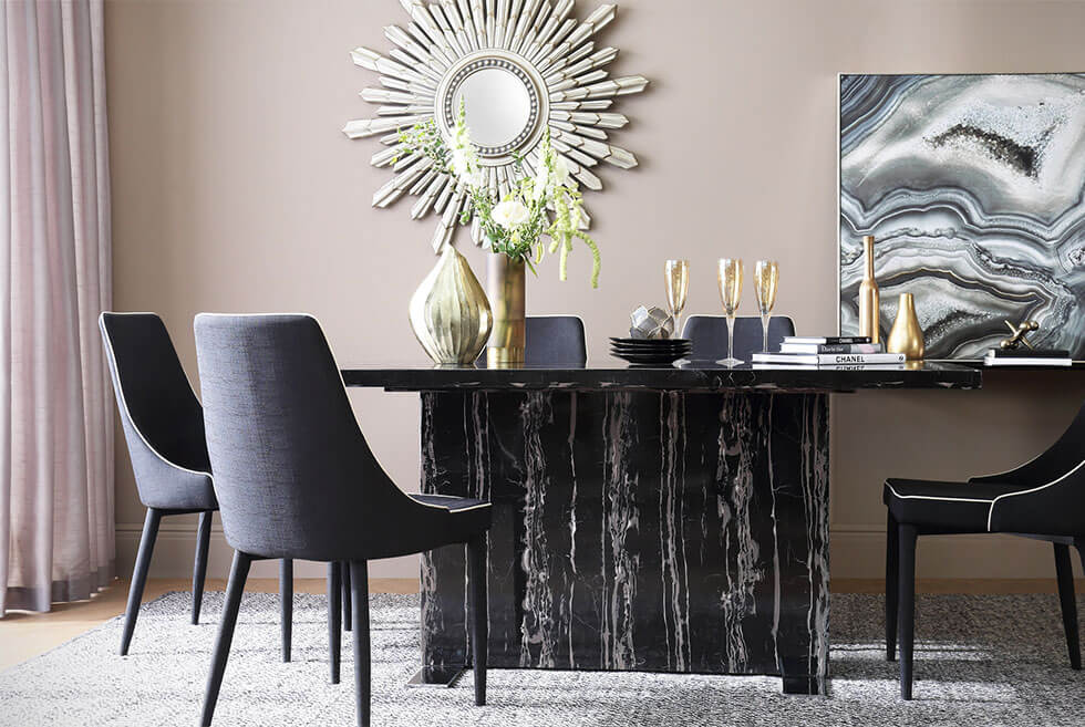 Black marble dining table in a modern luxe setting