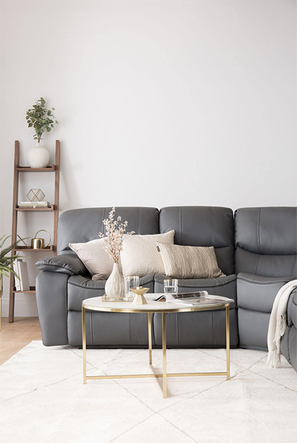 Grey leather corner sofa in a contemporary luxe living room