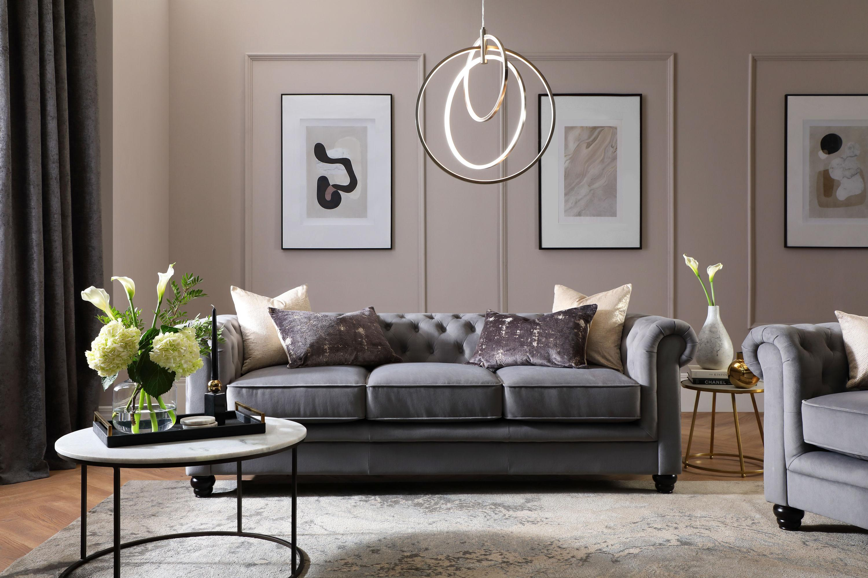 Grey velvet chesterfield sofa in a chic and luxe living room
